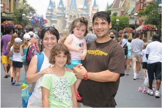 Snannon and her beautiful family at Disney