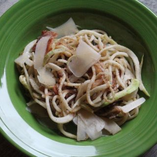 Kohlrabi Spaghetti with Caramelized Onions, Bacon, and Shaved Parmesan